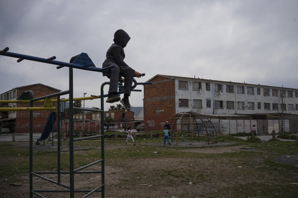 A child plays in a playground in Cape Flats, and area in Cape Town, South Africa, notorious for its gang wars and high numbers of child murders, on Se...