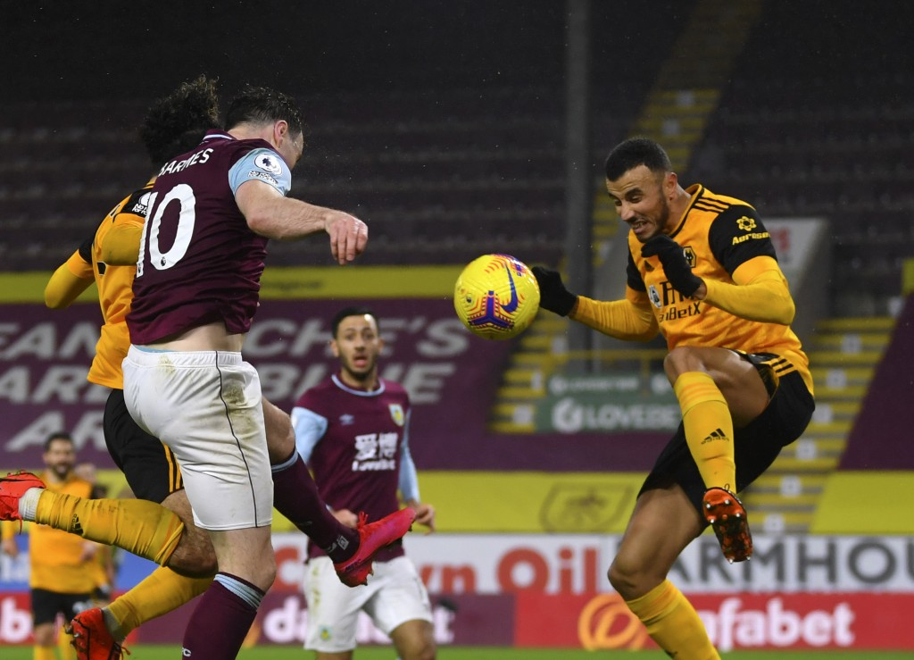 Burnley's Ashley Barnes, front left, scores his side's opening goal during the English Premier League soccer match between Burnley and Wolverhampton W...