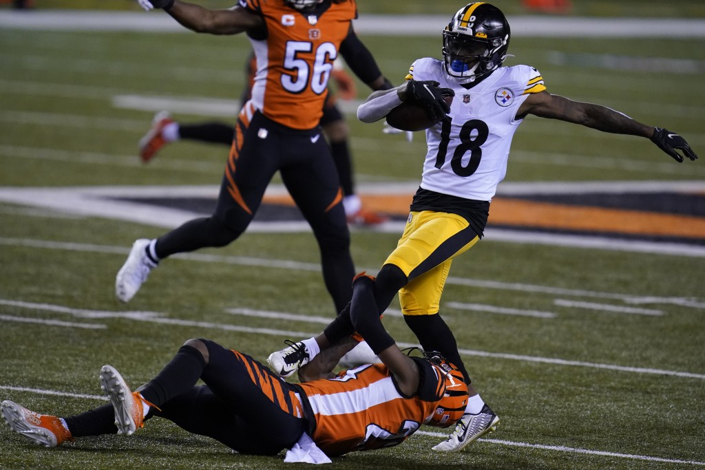 Pittsburgh Steelers' Diontae Johnson (18) is tackled by Cincinnati Bengals' Darius Phillips (23) during the first half of an NFL football game, Monday...