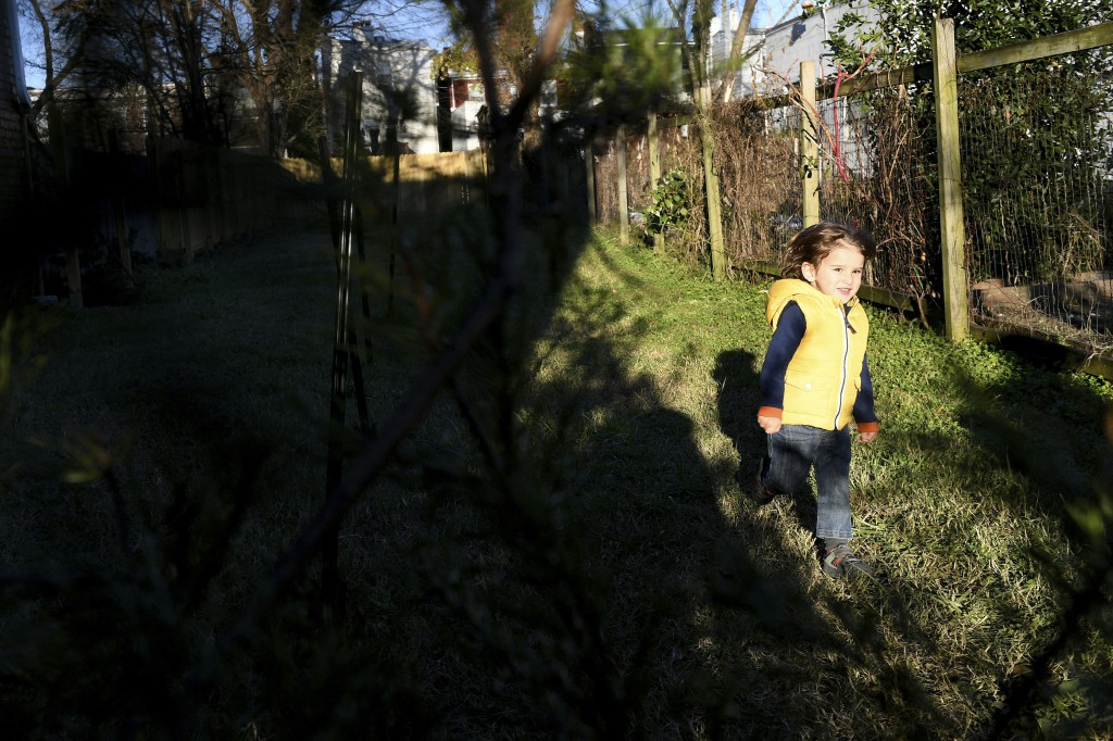Desi Alvarez, 2, runs towards his mother Marlysse Simmons (not pictured) while she shops for trees at Frank Pichel's tree lot, Sunday, Dec. 6, 2020, i...