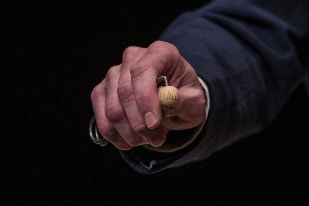 A worker shows El Gordo, or The Fat One, prize at Madrid's Teatro Real opera house during Spain's bumper Christmas lottery draw in Madrid, Spain, Tues...