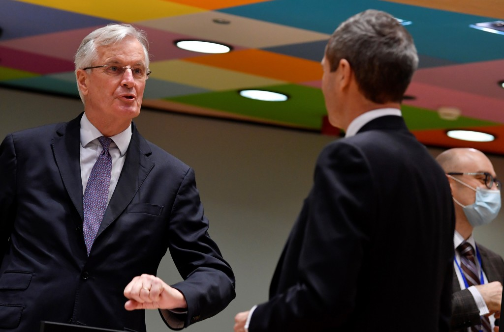 European Union's chief Brexit negotiator Michel Barnier, left, speaks with Ambassador Michael Clauss, Permanent Representative of Germany to the Europ...