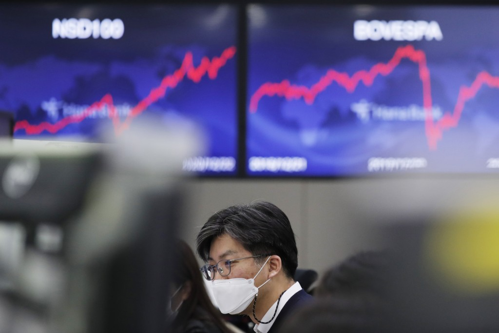A currency trader watches computer monitors at the foreign exchange dealing room in Seoul, South Korea, Wednesday, Dec. 23, 2020. Asian stock markets ...