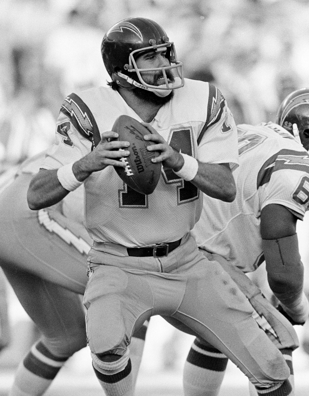 FILE - In this Dec. 27, 1982, file photo, San Diego Chargers quarterback Dan Fouts (14) looks downfield before releasing a pass against the Baltimore ...