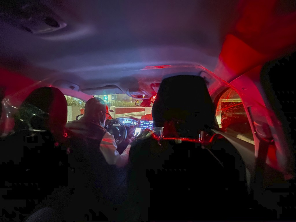 A taxi driver takes passengers to their destination in Paris after they arrived at Charles de Gaulle airport Tuesday Dec. 22, 2020. More and more coun...