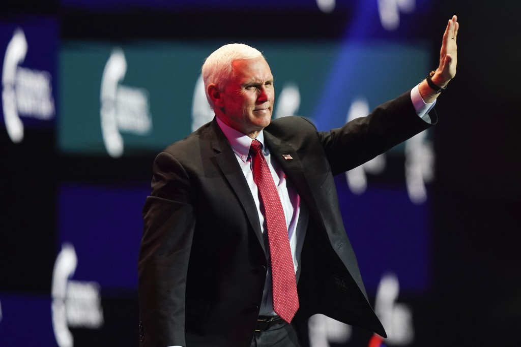 Vice President Mike Pence waves as he walks off the stage after speaking at the Turning Point USA Student Action Summit, Tuesday, Dec. 22, 2020, in We...