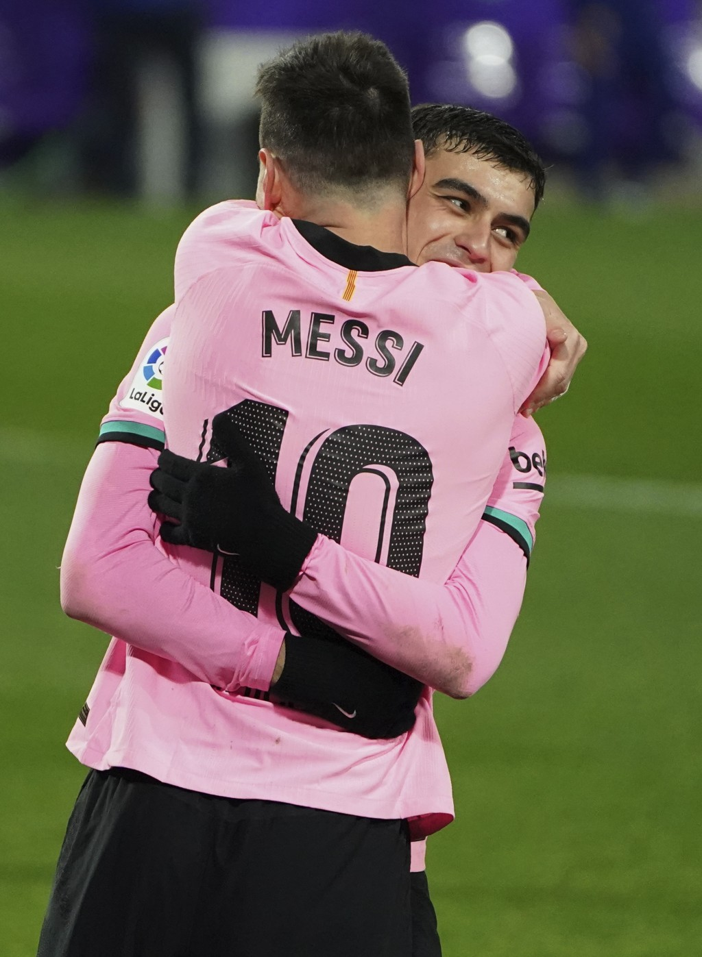 Barcelona's Lionel Messi, left, celebrates with Pedri after scoring his side's third goal during a Spanish La Liga soccer match between Valladolid and...