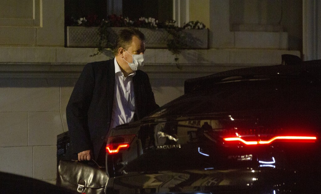 Britain's chief negotiator David Frost leaves the UK ambassadors residence in Brussels, Wednesday, Dec. 23, 2020. Talks continued Wednesday in the bid...