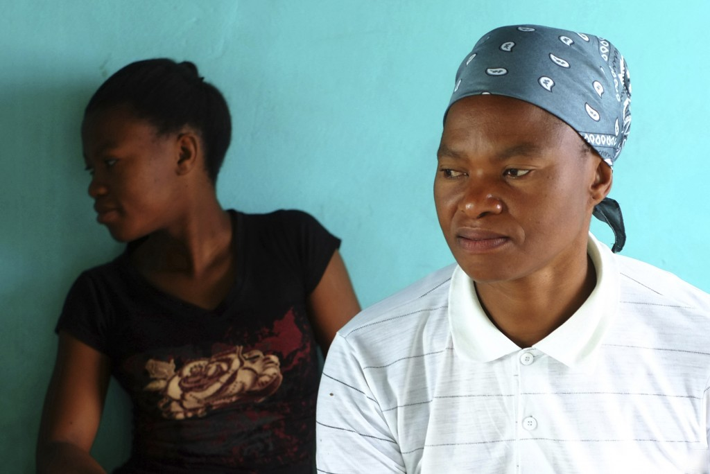 Matefo Litali, 53, a Lesotho garment worker, and her 20-year-old daughter, Refiloe, sit together in their shared room in the town of Ha Thetsane, Mase...