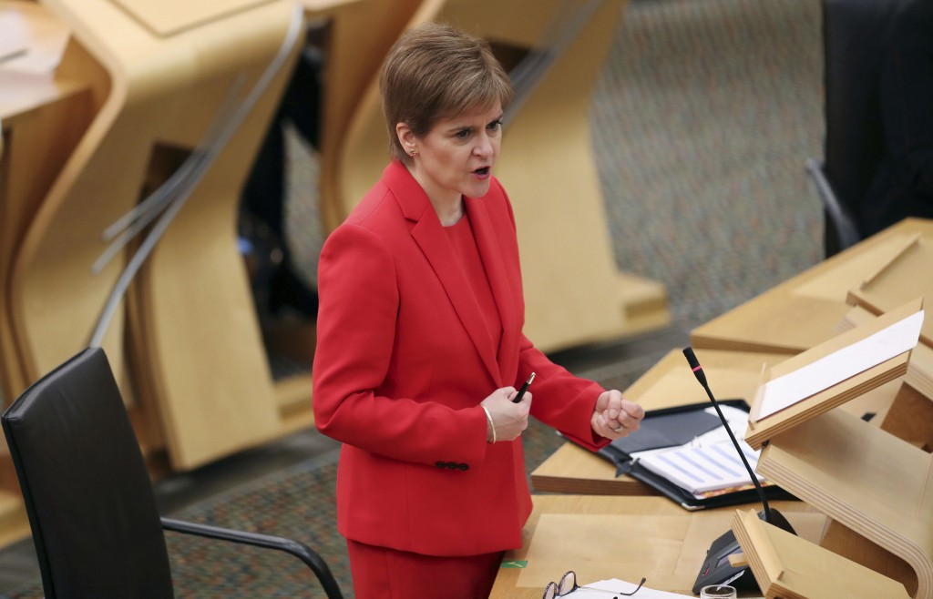Scotland's First Minister Nicola Sturgeon gives an update on COVID-19 restrictions, at the Scottish Parliament in Edinburgh, Scotland, Tuesday Dec. 22...