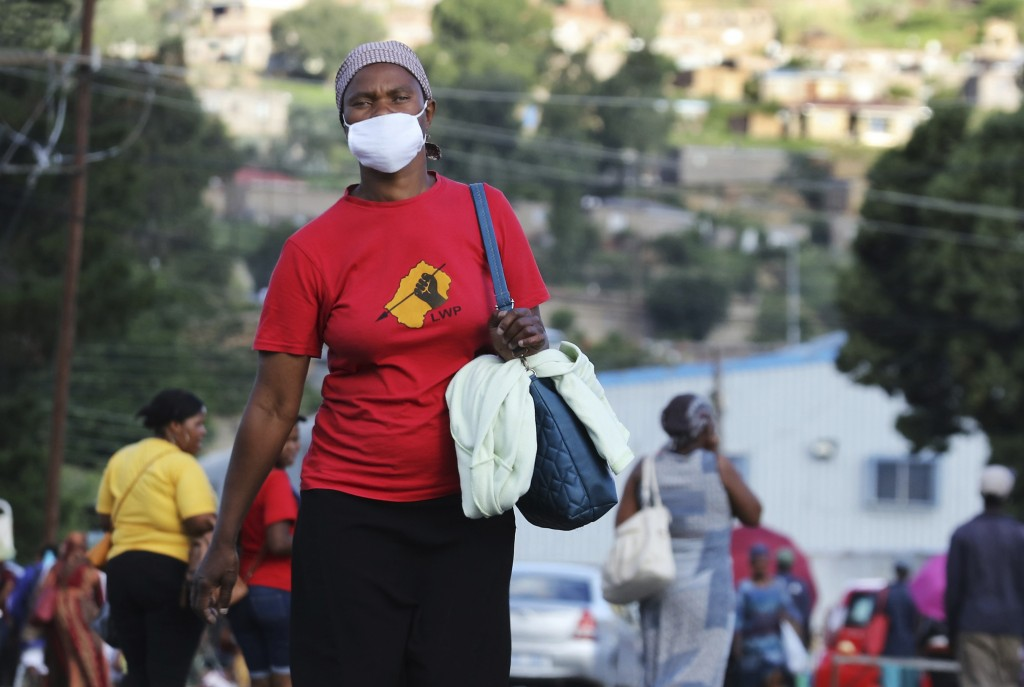 Matefo Litali, 53, a garment worker and staunch supporter of Lesotho Workers Party (LWP), walks down a street in Maseru, Lesotho, on Friday, Dec. 11, ...