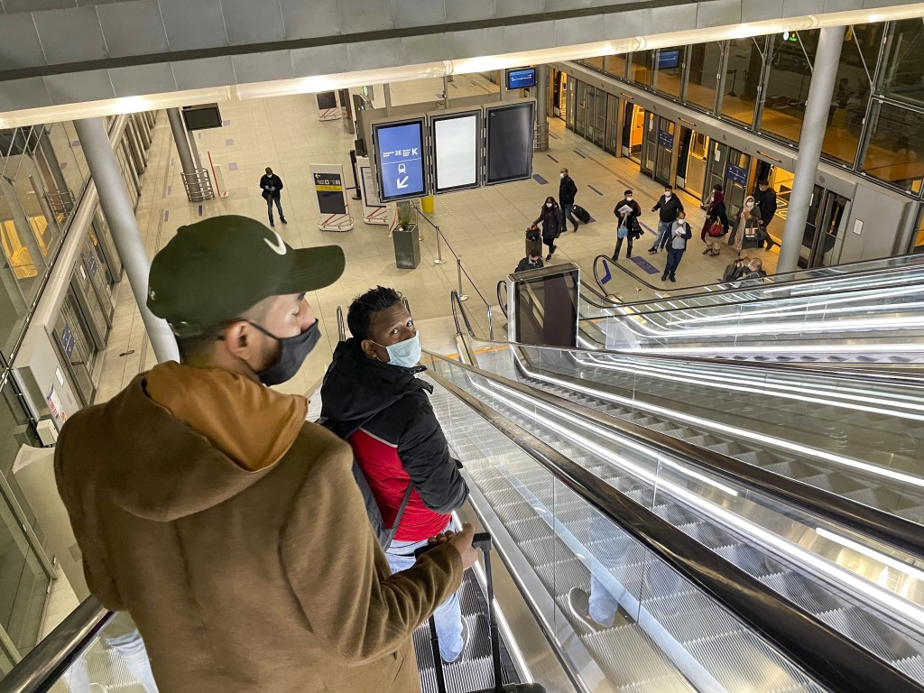 Arriving and departing passengers use the train link between two terminals at Paris Charles de Gaulle airport Tuesday Dec. 22, 2020. More and more cou...