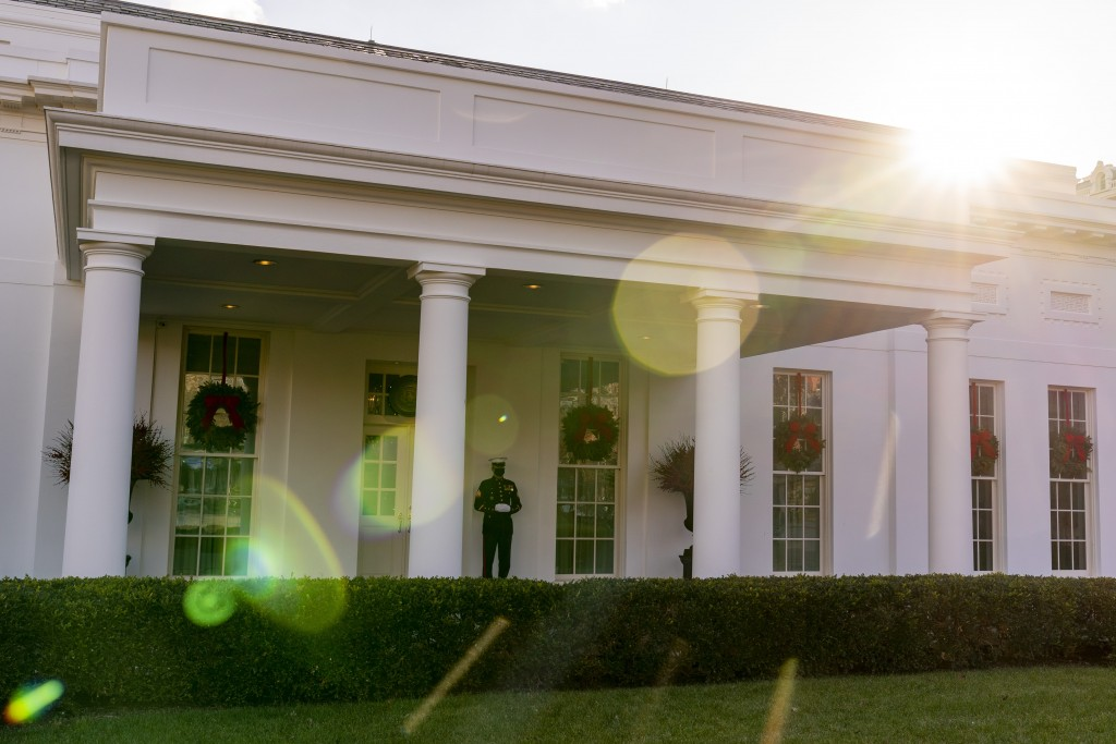 A Marine stands outside the entrance to the West Wing of the White House, signifying the President is in the Oval Office, Tuesday, Dec. 22, 2020, in W...