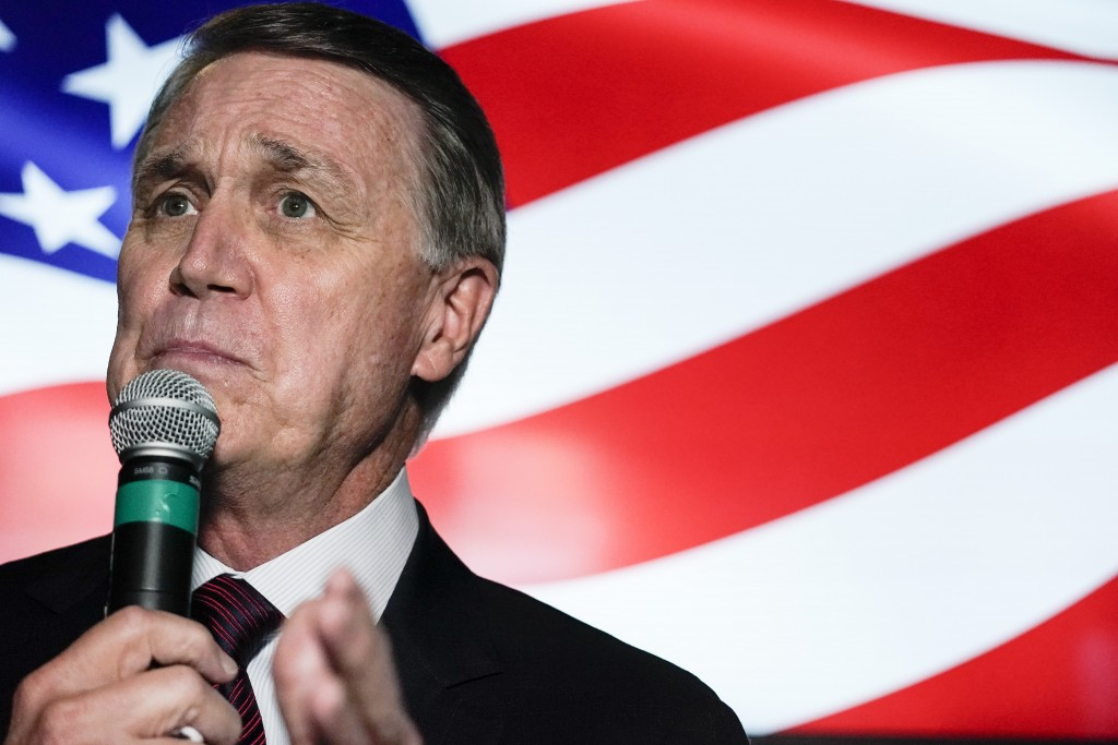 FILE - In this Friday, Nov. 13, 2020 file photo, candidate for U.S. Senate Sen. David Perdue speaks during a campaign rally, in Cumming, Ga. Perdue is...