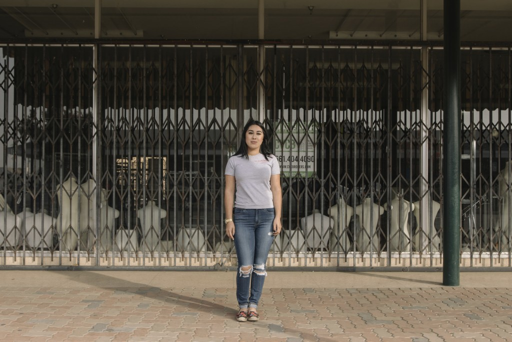 """Alexandra Orozco stands for a portrait outside of the closed J.C. Penney where she was laid off from, in Delano, Calif., on Sunday, Dec. 6, 2020. """"Not..."""