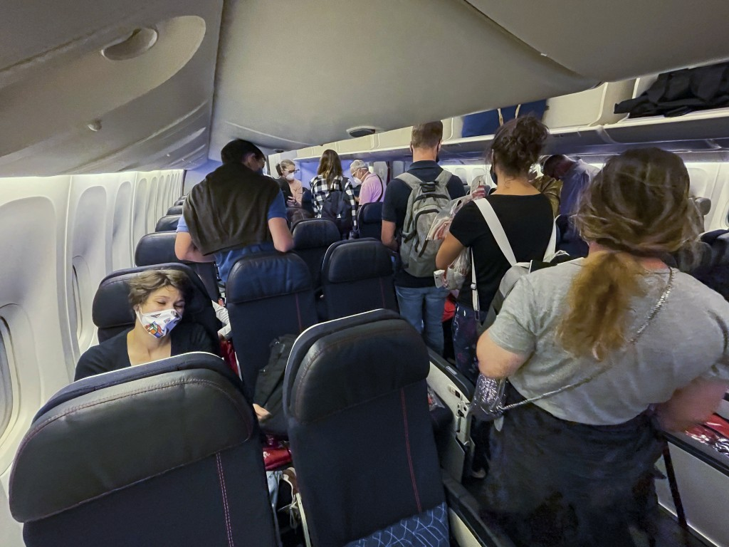 Passengers board an Air France flight bound for Paris at Johannesburg's OR Tambo airport Monday Dec. 21 2020. More and more countries around the world...