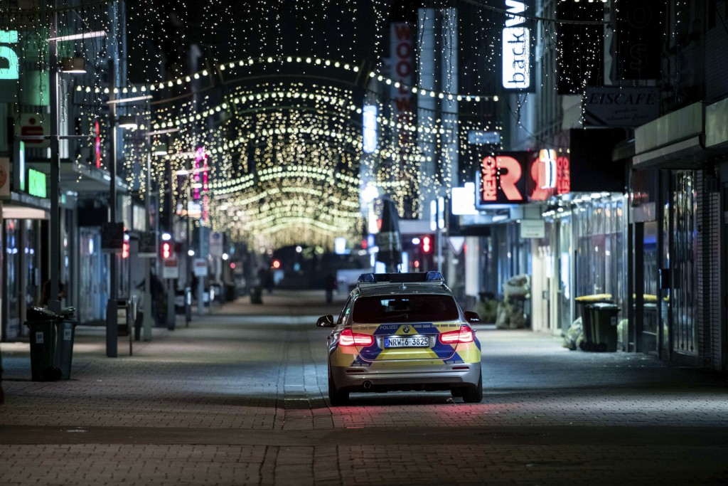 """Police control together with the public order office as there are hardly any people on the shopping street """"Marktstrasse"""" in the city centre of Oberha..."""
