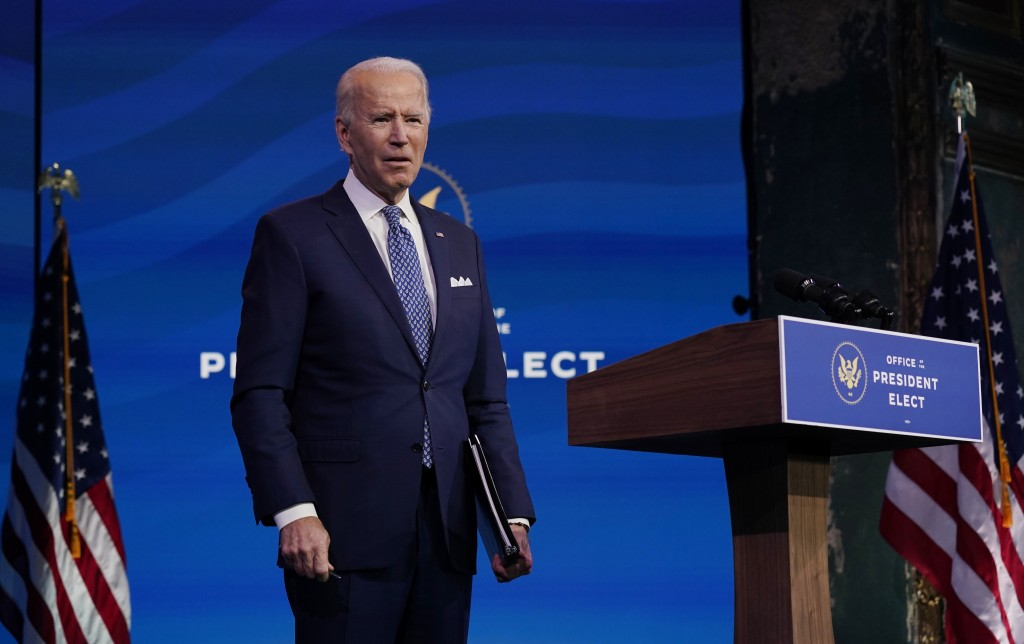 President-elect Joe Biden pauses as he leaves to listen to a reporter's shouted question at The Queen Theater in Wilmington, Del., Tuesday, Dec 22, 20...