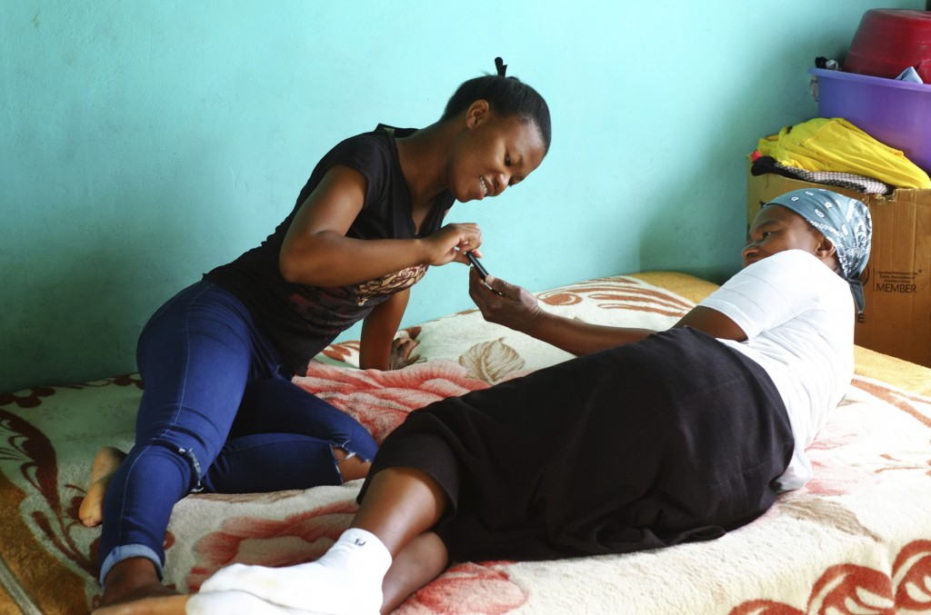 Matefo Litali, 53, a Lesotho garment worker, spends time with her 20-year-old daughter, Refiloe, whom she shares a room with, in the town of Ha Thetsa...