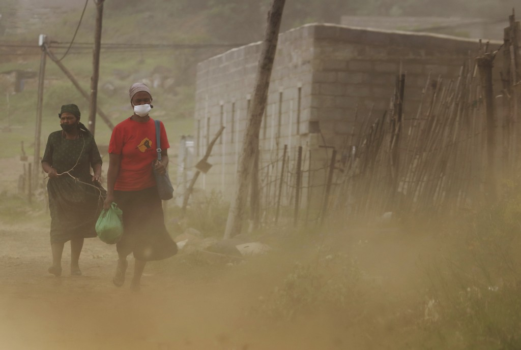 Matefo Litali rushes home to prepare dinner for her family in Maseru, Lesotho, on Friday, Dec. 11, 2020. She starts working at 7 a.m. and finishes by ...