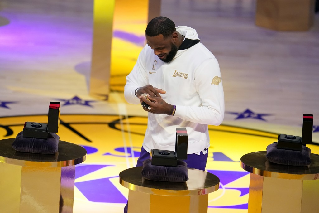 Los Angeles Lakers forward LeBron James receives his NBA championship ring before an NBA basketball game against the Los Angeles Clippers, Tuesday, De...