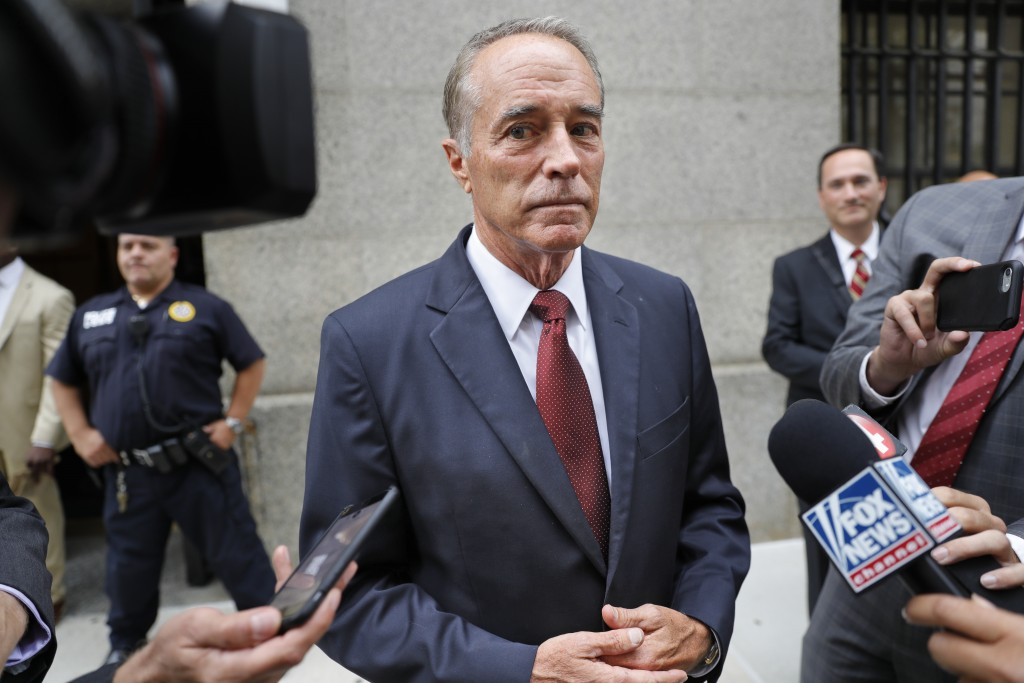 FILE - In this Thursday, Sept. 12, 2019, file photo, U.S. Rep. Chris Collins, R-N.Y., speaks to reporters as he leaves the courthouse after a pretrial...