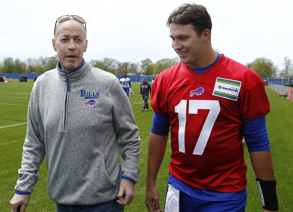 FILE - In this May 11, 2018, file photo, Buffalo Bills rookie quarterback Josh Allen (17) walks with Hall of Fame quarterback Jim Kelly following the ...