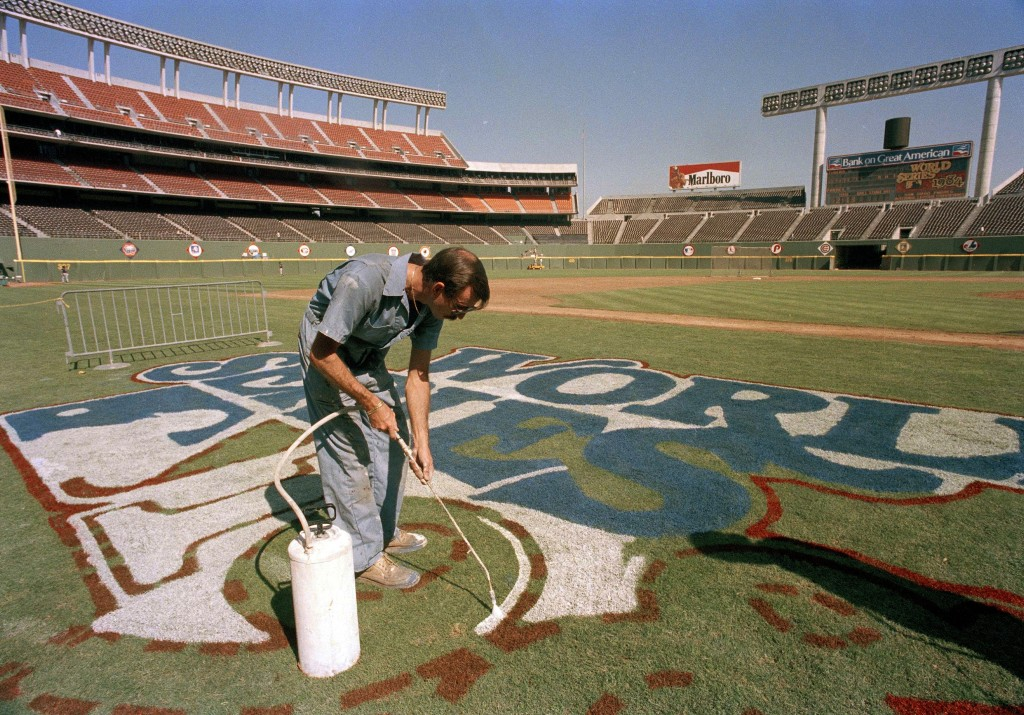 FILE - In this October 1984 file photo, a groundskeeper at Jack Murphy Stadium paints the logo for the 1984 World Series between San Diego Padres and ...
