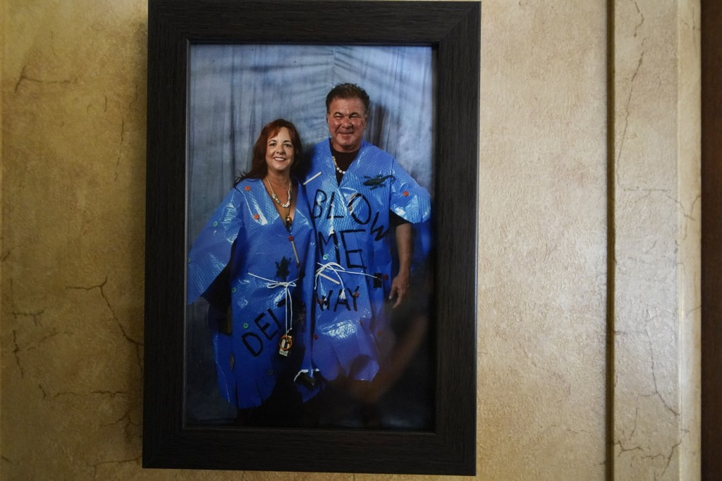 A framed photo of Dewana Young and her husband Pete is seen, as they are dressed in Halloween costumes, as hurricanes Laura and Delta, in the aftermat...