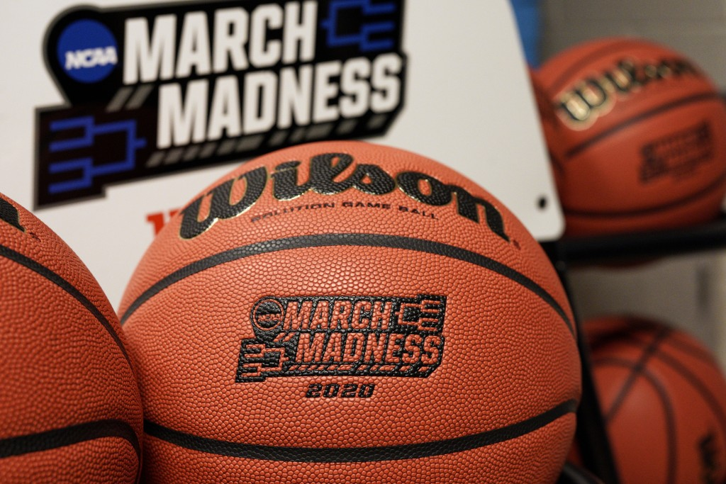 FILE - In this March 16, 2020, file photo, official March Madness 2020 tournament basketballs are displayed in a storeroom at the CHI Health Center Ar...