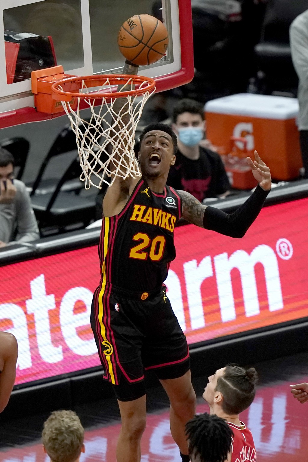 Atlanta Hawks' John Collins dunks against the Chicago Bulls during the first half of an NBA basketball game in Chicago, Wednesday, Dec. 23, 2020. (AP ...