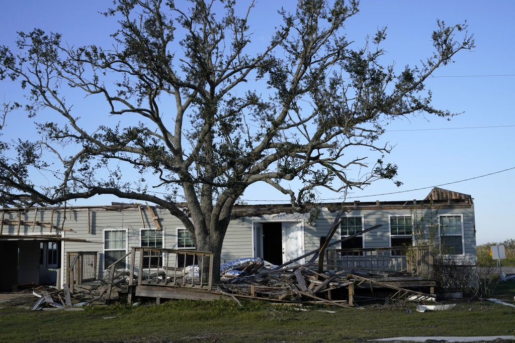 A destroyed home is seen in the aftermath of both Hurricane Laura and Hurricane Delta, in Grand Lake, La., Friday, Dec. 4, 2020. (AP Photo/Gerald Herb...