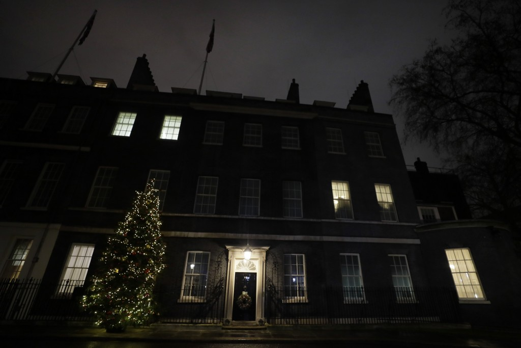 A view of the Christmas tree outside 10 Downing Street in London as people wait for news on Brexit trade talks, Wednesday, Dec. 23, 2020. European Uni...