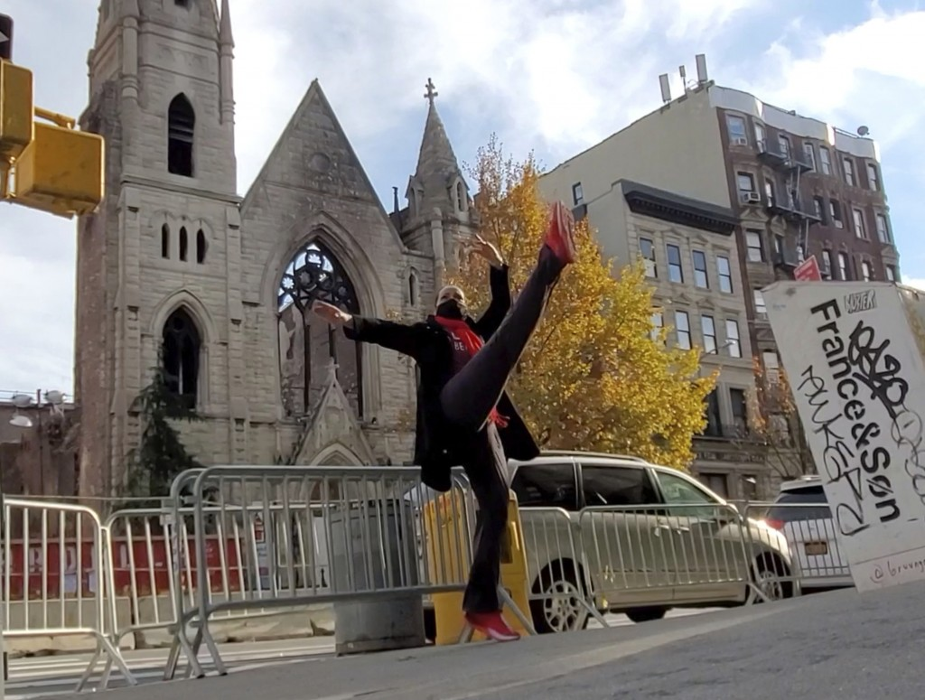 In this Dec. 12, 2020 image taken from video, professional dancer Adrienne Hurd performs in front of the facade of New York City's 128-year-old Middle...