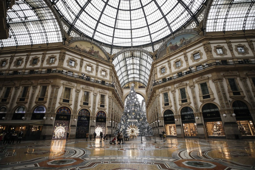 The almost deserted Galleria Vittorio Emanuele II shopping arcade, in Milan, Italy, Thursday, Dec. 24, 2020. Italy went into a modified nationwide loc...