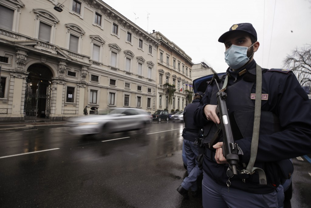 Police officers check vehicles in Milan, Italy, Thursday, Dec. 24, 2020. Police were out in force Thursday imposing new COVID-19 travel restrictions a...