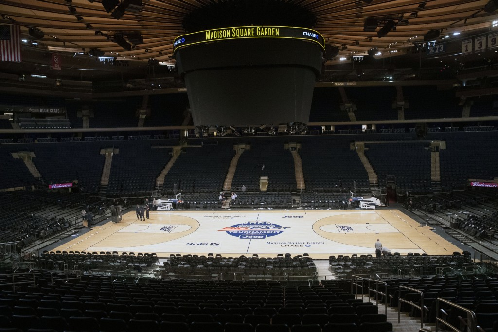 FILE - In this March 12, 2020, file photo, Madison Square Garden  in New York sits  empty after NCAA college basketball games in the men's Big East Co...