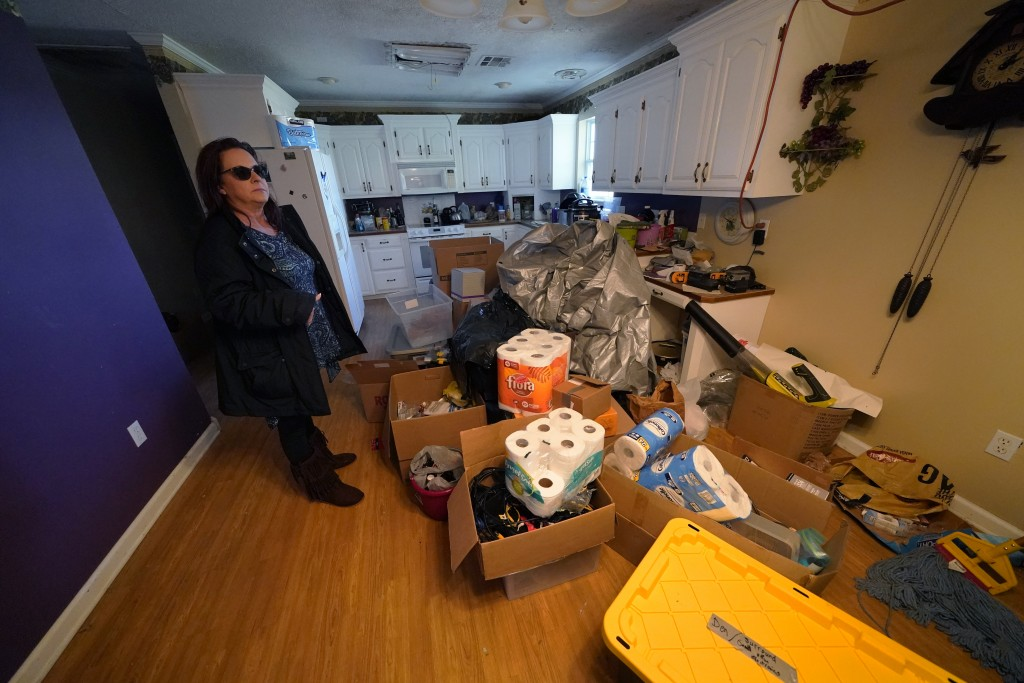 Provisions are piled on the floor of Dewana Young's heavily damaged home, in the aftermath of both Hurricane Laura and Hurricane Delta, in Grand Lake,...