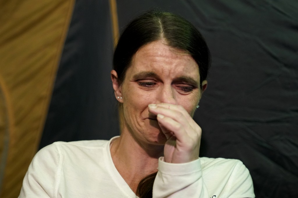 CORRECTS SPELLING TO CRISTIN, INSTEAD OF CRISTEN - Cristin Trahan cries inside a tent where she now lives with her husband, where their home once stoo...