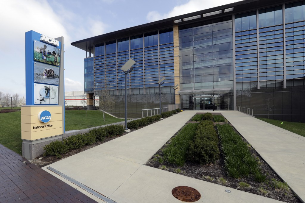 FILE - This is an April 25, 2018, file photo, showing NCAA headquarters in Indianapolis. As 2020 came to a close, there were at least 116 Division I p...