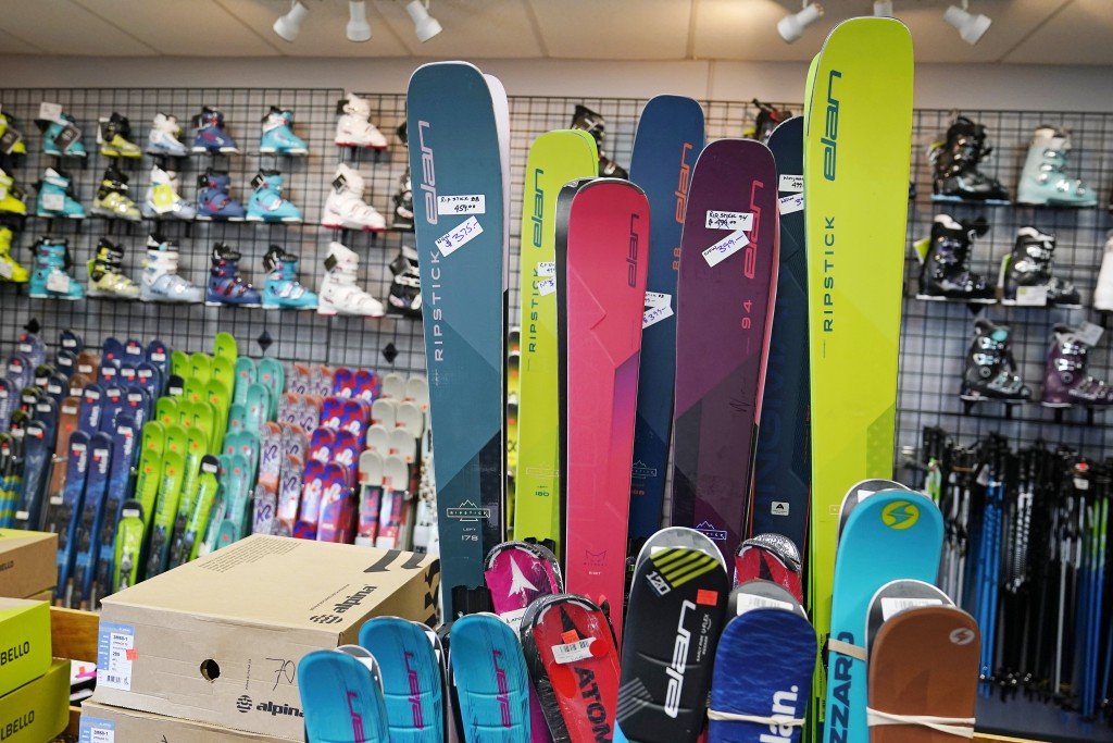 Skis and boots are displayed in the ski shop at McIntyre Ski Area, Wednesday, Dec. 16, 2020, in Manchester, N.H. Over the summer, people looking to ge...