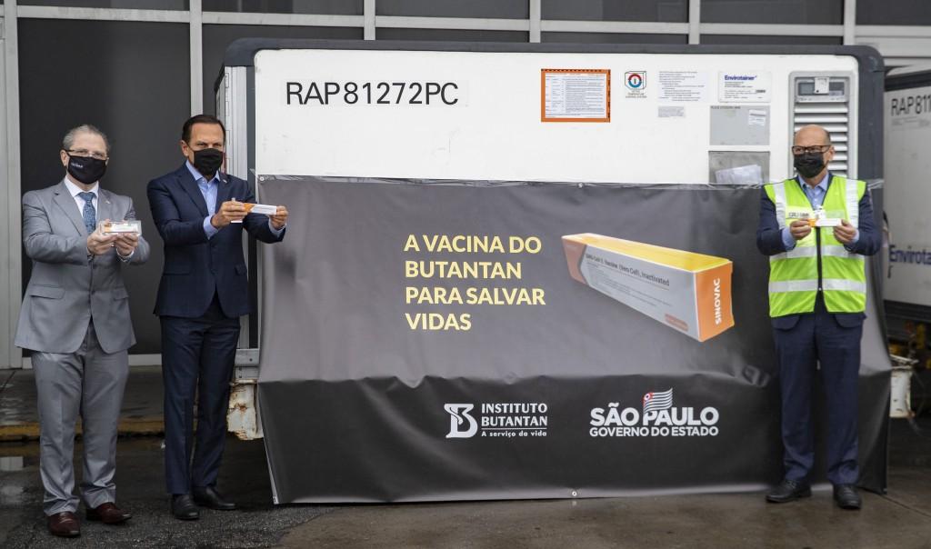 FILE - In this Nov. 19, 2020, file photo, Sao Paulo Governor Joao Doria, second from left, Sao Paulo state Health Secretary Dr. Jean Gorinchteyn, left...