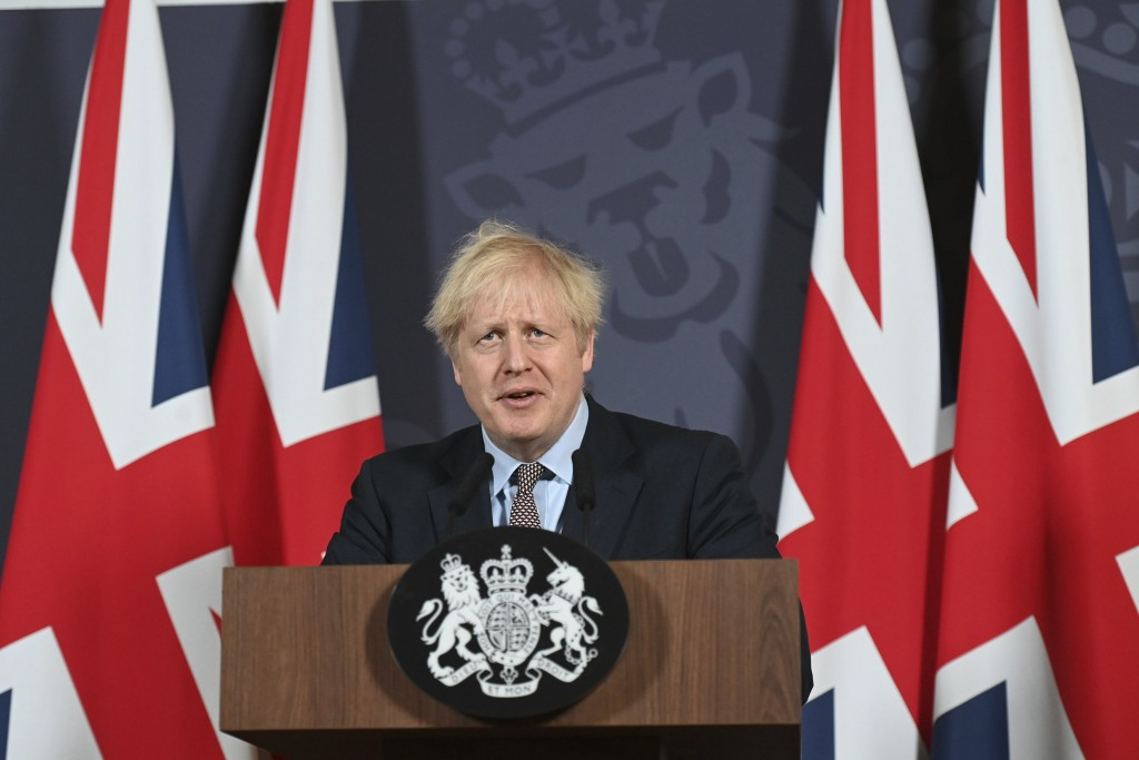 Britain's Prime Minister Boris Johnson speaks during a media briefing in Downing Street, London, Thursday, Dec. 24, 2020. Britain and the European Uni...