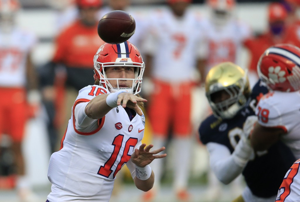 FILE - In this Saturday, Dec. 19, 2020, file photo, Clemson quarterback Trevor Lawrence (16) throws to an open receiver during the first half of the A...