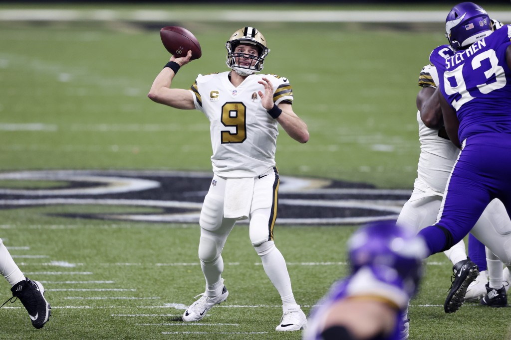 New Orleans Saints quarterback Drew Brees (9) passes in the first half of an NFL football game against the Minnesota Vikings in New Orleans, Friday, D...