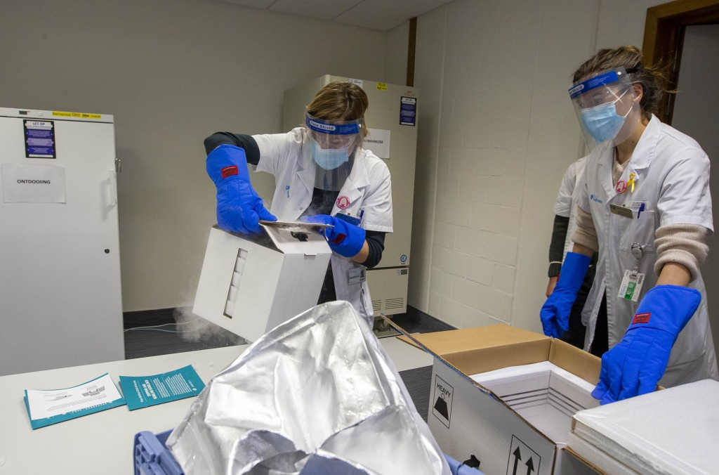 Medical staff receive part of a Pfizer-BioNTech Covid-19 vaccine shipment at the UZ Leuven hospital in Leuven, Belgium, Saturday, Dec. 26, 2020. Belgi...