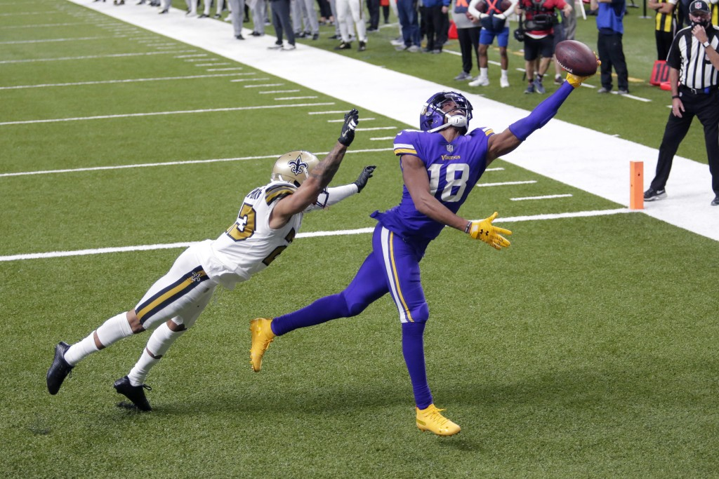 Minnesota Vikings wide receiver Justin Jefferson (18) tries in vain to pull in a pass over New Orleans Saints cornerback Marshon Lattimore in the end ...