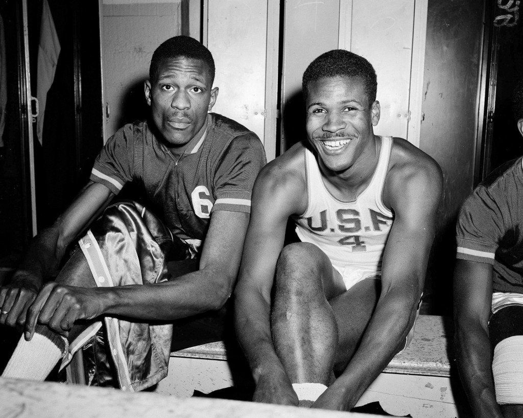 FILE - In this March 1, 1956, file photo, K.C. Jones, captain of the University of San Francisco Dons, right, is shown with teammate Bill Russell in S...