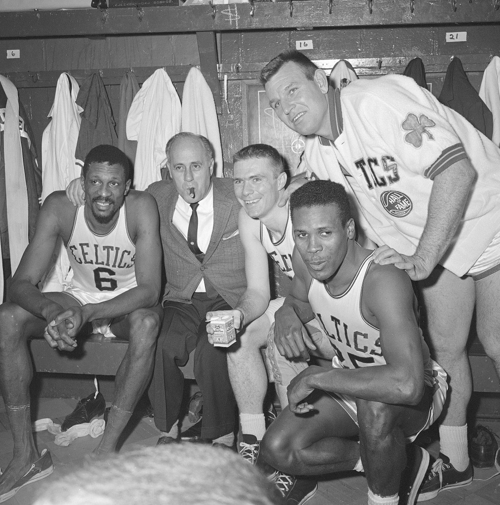 FILE - In this April 9, 1964, file photo, Boston Celtics, from left, Bill Russell, coach Red Auerbach, Tommy Heinsohn, Jim Locustoff, and K.C. Jones c...