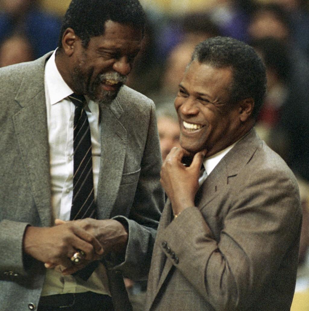 FILE - In this Jan. 15, 1988, file photo, former Boston Celtics teammates Bill Russell, Sacramento Kings coach, left, and K.C. Jones, Celtics coach, m...